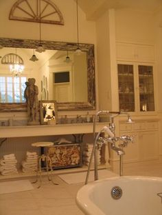 built in cabinetry and rustic mirror