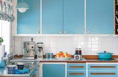 colorful cabinets with white tile backsplash