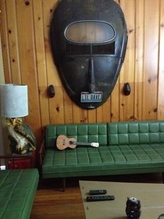 Green couch with African mask like VW wall decor