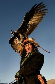 Mongolian Eagle Hunter. Falconry developed in Central Asia and for centuries, Kazakh men hunted from horseback with trained golden eagles, the largest and most powerful of raptors.
