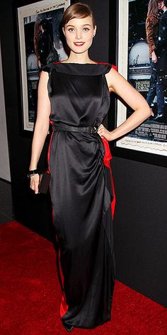 Not Fade Away premiere (opting for a red-and-black palette), the film's star looks elegant in a two-tone draped Lanvin gown, Swarovski earrings and on-trend wine lips.