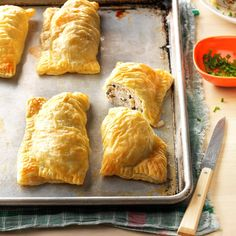 "Puff Pastry Chicken Bundles Recipe -Inside these golden puff pastry ""packages"", chicken breasts rolled with spinach, herbed cream cheese and walnuts are a savory surprise. I like to serve this elegant entree when we have guests or are celebrating a holiday or special occasion. -Brad Moritz, Limerick, Pennsylvania"