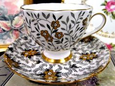 TUSCAN TEA CUP AND SAUCER BLACK & GOLD PAINTED TEACUP PATTERN GOLD GILT