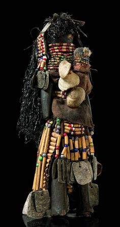 Africa | Fertility doll from the Turkana people of Kenya | Wood, elabroately decorated with fabric, wood tues, glass beads, metal and shells