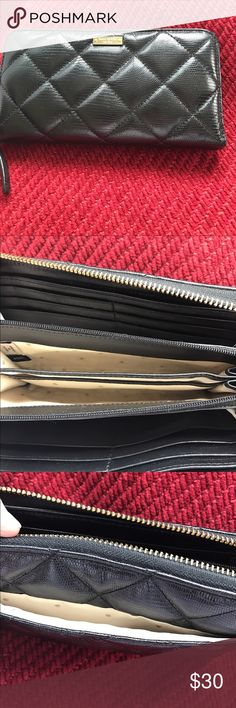 Kate Spade Quilted wallet Black quilted wallet / numerous slots for credit cards size 8 x 4  good condition/ normal wear! kate spade Other