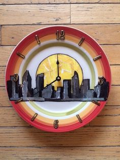 CITY SCENE DESIGN decoupage clocks made from recycled plates by crazyclocklady on Etsy https://www.etsy.com/listing/219213824/city-scene-design-decoupage-clocks-made