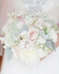 Textured clutch of peonies, roses, and variegated phaleonopsis orchids