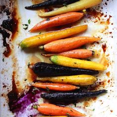 Roasted Carrots Easy maple glazed oven roasted whole rainbow carrots are a beautiful and healthy vegetable side dish. Roasted carrots are perfect for a healthy Thanksgiving or holiday side but easy enough for weeknight dinner. Roasted Whole Carrots, Baked Carrots, Rainbow Carrot Recipes, Easy Vegetable Side Dishes, Veggie Dishes, Vegetable Recipes, Thanksgiving Vegetable Sides, Recipes, Side Dishes