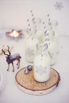 Snowflake decorated milk bottles - super cute and festive for Christmas #PumpkinPatchWishlist #PumpkinPatchWishlist