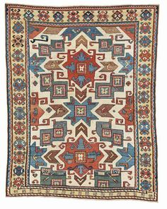 A WHITE GROUND 'STAR' KAZAK RUG, SOUTH CAUCASUS, MID 19TH CENTURY. Christies 'Oriental Rugs