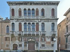 Palazzo Ca' Tron Canal Grande Venezia.The palace was rebuilt in the late 16th cent.,under the design of an unknown architect influenced by Jacopo Sansovino as the residence of the Tron family, who lived here until their extinction in the 19th cent. The Tron had lived in this parish by the time of the start of the Patriciate.The family produced on Doge,Niccolo Tron in 1471,and nearly a half dozen procurators,and many other Venetian statesmen and generals. Maximilian,Elector of Bavaria,stayed…
