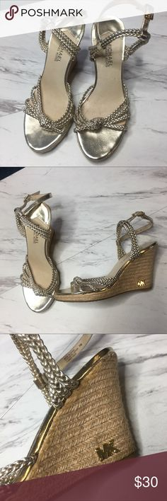 Michael Kors Gold Wedge Sandals Gently used size 7 michael michael Kors gold woven wedges. Runs true to size. Kept in a smoke free environment. Accepting all questions and reasonable offers ♥️ MICHAEL Michael Kors Shoes Wedges