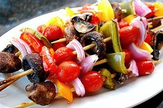 Simply skewer on your desired vegetables (I used grape tomatoes, cremini mushrooms, red/green/yellow/orange bell peppers, and red onion) and place in a baking dish. Drizzle Italian dressing over them to coat and toss. Cover and refrigerate until ready to use - the longer the better! You can grill them or even roast them in a 350 degree oven for 12-15 minutes.