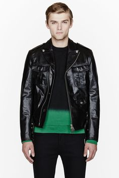 DSQUARED2 //  Black calf leather military kiodo jacket  32148M032004  Long sleeve buffed leather bomber jacket in black. Deeply notched lapel collar with press-stud fixtures. Off-center two-way zip and button closures at front. Epaulet shoulders. Flap pockets and zippered welt pockets at front. Pin-buckle belt at front hem. Seam pocket at interior. Fully lined. Tonal stitching. Zippered sleeve cuffs. Shell: 100% calf leather. Filling: 100% polyester. Specialty cleaners. Imported.  $3080 CAD