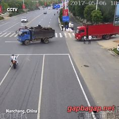 GIF Of Chinese Motorcyclist Crashing Into Truck An...Hope that guy didn't die....really sad