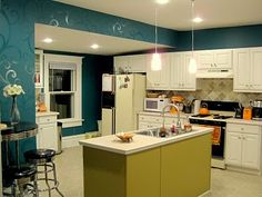 Love this kitchen, especially that wall!  Paint the wall with flat paint and then paint a design in the exact same shade, only with glossy paint for a cool tone on tone effect.
