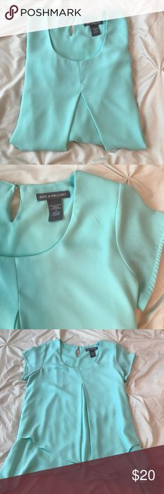 Mint Flowy Asymmetrical Blouse This mint top is perfect for summer as the material keeps you cool and has a beachy tone color. Pairs great with white jeans or shorts with wedges. Gently used once. Size is medium but I believe runs a bit big. I wore as an oversized Blouse. Tops