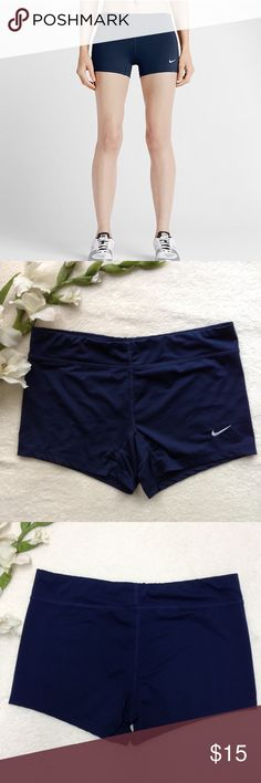 """Nike Dri-Fit Volleyball Athletic Shorts Navy blue athletic spandex shorts from Nike. Dri-Fit moisture wicking fabric, comfortable fit and room to move for high impact sports. Lined inseam gusset for extra comfort and range of motion. 82% polyester 18% spandex machine wash. Size M. Approx flat meas: outer length 9.5"""", center length 11.5"""", inseam 3"""", waist 15"""". EUC no rips stain or holes. Like new. Nike Shorts"""