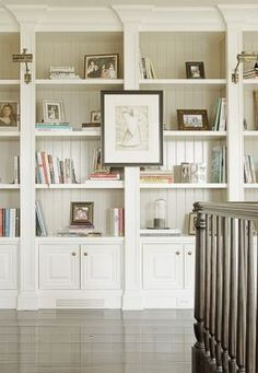 sucker for built in bookcases with moldings.... Like the painted bead board on the back of the shelves.