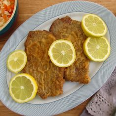 Breaded escalopes | Food From Portugal. Want to prepare a simple and tasty lunch? We suggest this breaded escalopes recipe, ideal for a home-cooked meal, a party or a family picnic! Try it!!   http://www.foodfromportugal.com/recipe/breaded-escalopes/