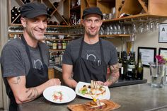 DAIRY-FREE AND FLAVORFUL: Plant chef Jason Sellers, left, and sous-chef Nathan Burrows pair their house-made aged cashew cheese, almond-based fresh mozzarella and dairy-free cream cheese with heirloom tomoatoes, herbs, pickled vegetables, focaccia and more on the vegan restaurant's cheese plate and tomato plate. Photo by Cindy Kunst