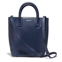 This structured leather tote does double-duty as a shoulder bag with its optional shoulder strap—in navy, it makes for a subtle and equally versatile alternativ