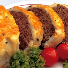 An all-time family favorite! Savory meat loaf with mashed potatoes and cheese on top.