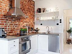 small kitchen design brick backsplash white cabinets floating shelves