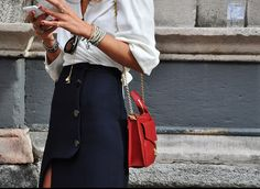 Great simple combination, black, white and a little bit of red. Tommy Ton