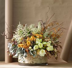 A birch-lined glass vase holds this arrangement from Dirt Floral, which includes… Fall Flowers, Fresh Flowers, Beautiful Flowers, Wedding Flowers, Estilo Floral, Arte Floral, Fall Arrangements, Beautiful Flower Arrangements, Holiday Centerpieces