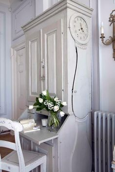 a-cottage-in-the-woods:  source: Swedish Interior Design  1780 Gustavian cabinet with antique mora clockin the side