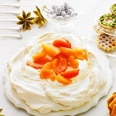 A snowy pavlova is topped with vanilla-poached orange slices_MStewart