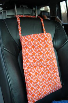Orange Geometric Flowers Auto Trash (or anything storage) Bag Use coupon code HOLIDAY20 to receive 20% off your minimum order of $25.00! Domestic orders only. Exp 12.22.13