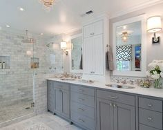 Grey and white bathroom with walk-in shower and pony wall for privacy. Description from pinterest.com. I searched for this on bing.com/images