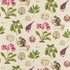 Capuchins Fabric A woven curtain fabric featuring large prints of capuchin monkeys, parrots, flowers with green foliage and pomegranates on a beige background.