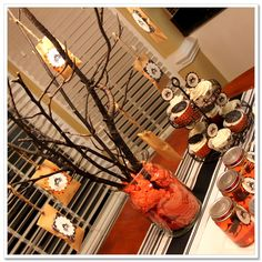 Halloween Party Ideas - cool centerpiece - use a mason jar with the stick and put white stuff in the bottom and put in dining room...as centerpiece for the candy bar can hang the treat sacks