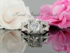 8.5mm Round Forever One Moissanite and Diamond Halo Engagement Ring in 14k White Gold (avail. in rose gold, yellow gold and platinum) by KaratJewelryGroup on Etsy https://www.etsy.com/listing/498917421/85mm-round-forever-one-moissanite-and