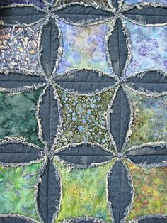 Faux cathedral windows, batiks with denim, raw edge showing fraying