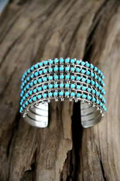 One hundred and five tiny Sleeping Beauty turquoise stones in a Zuni petit point cuff