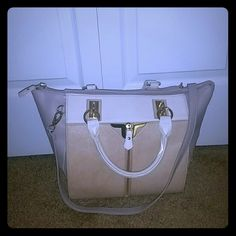 Danielle nicole purse Beautiful used 3 times great structure multi compartment double side look greyish lilac and nude last pic shows use on handle. This is not leather ! taking offers don't be shy Danielle Nicole Bags