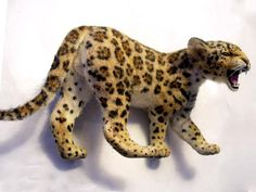 Jaguar.  Hand sculpted by Linda Fisher.
