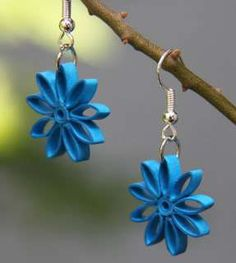 Unique handcrafted earrings!  These earrings are crafted from the art of paper quilling. Made from specialty papers and with a water resistant coating, these earrings are light weight, unique, an…
