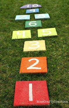 20+ DIY Yard Games that are perfect for summer entertaining, like this Giant Rainbow Hopscotch from Happiness is Homemade! These awesome lawn games for adults and kids - like cornhole, giant Jenga, Yardzee, tic tac toe + more - are perfect for backyards, camping trips, and family fun. Learn how to make DIY yard games from these easy tutorials, then enjoy these game all summer long! | Hello Little Home
