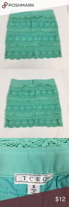TCEC Mint Green Lace Crochet Mini Skirt TCEC Boutique Crochet-style teal/ mint green skirt. Side zipper. Good condition. Size small. 28 inch waist and 15 inch length. 80% cotton and 20% polyester. Machine washable Skirts Mini