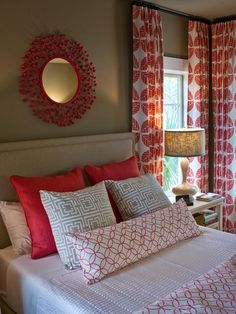 welcoming and cozy guest bedroom with red accents to liven up the space