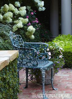 Carns Garden. Antique French chairs mix with new iron seating throughout and contribute to convivial gatherings. Picturesque Courtyard Garden | Traditional Home