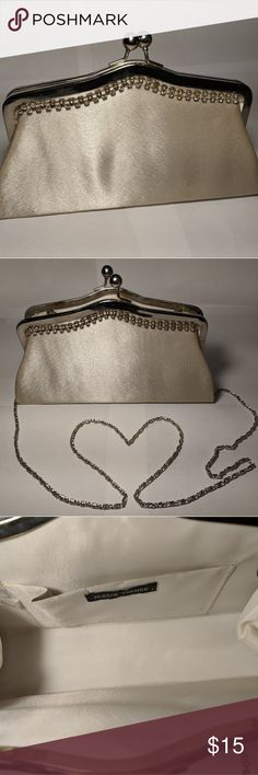 Bijoux Terner Wedding Clutch Bijoux Terner Wedding Clutch. Champagne with rhinestone detail. All stones intact! Used once.  Don't pay bridal store prices like I did! Includes a chain shoulder strap so you can keep tissues, lipstick, and your phone close at hand and stay hands free. It will fit an iPhone 10 (or Plus size) or a Pixel 2XL. Bijoux Terner Bags Clutches & Wristlets