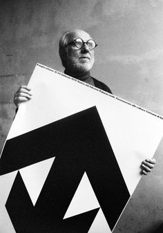 AG Fronzoni with his 1979 poster for 'The urban sign: investigation on the old town of Venice'.