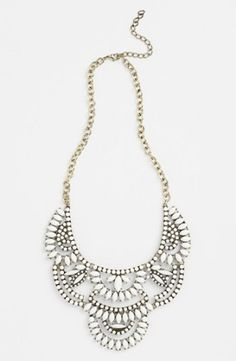 """Lovely white bib statement necklace to pair with any color. This is one of our most popular pieces. Approx 18"""" + 3"""" extension. Very adjustable. Can be worn closer to neck or drop down for a bib look."""