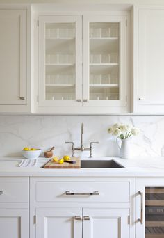 White galley kitchen by Kapito Muller Interiors.